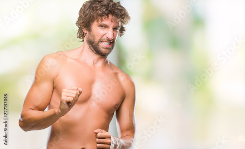 Handsome hispanic model man sexy and shirtless over isolated background disgusted expression, displeased and fearful doing disgust face because aversion reaction. With hands raised. Annoying concept.