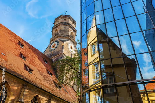 Stiftskirche with reflections in a glass facade in Stuttgart, Germany - 227166036