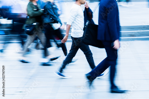 walking people in the city in motion blur