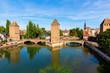 Leinwanddruck Bild - three bridges Pont Couverts over the river Ill in Strasbourg, France