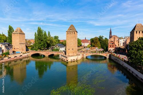 Leinwanddruck Bild three bridges Pont Couverts over the river Ill in Strasbourg, France