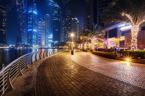 Beautiful view to Dubai Marina, UAE. Walking area. Long exposure time lapse effect at night