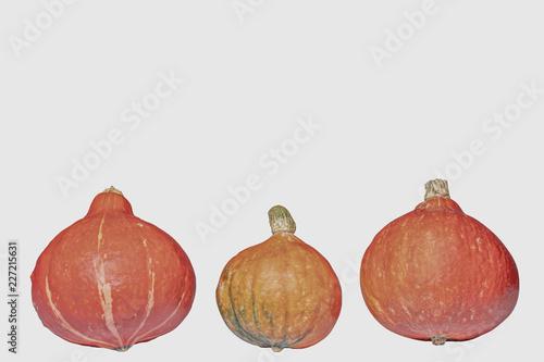 Foto Murales Drei Kürbisse stehen in einer reihe