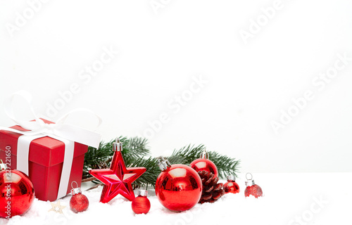 Red christmas holidays decoration on a white background © Production Perig