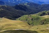 Top view of the hills and meadows overgrown with grass. Photographed in the Caucasus, Russia.