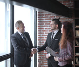 handshake is serious business partners in the office - 227234836