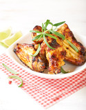 Teriyaki chicken wings. Baked chicken  with fresh rosemary. Homemade food. Symbolic image. Concept for a tasty and healty dish. Bright wooden background. Close up.  - 227250432