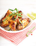 Teriyaki chicken wings. Baked chicken  with fresh rosemary. Homemade food. Symbolic image. Concept for a tasty and healty dish. Bright wooden background. Close up.  - 227250691
