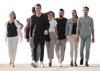 group of young people walking on the street