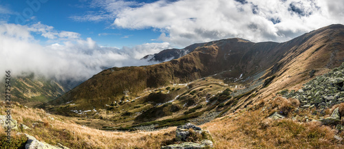 Panorama of amazing mountain landscape with blue sky and clouds