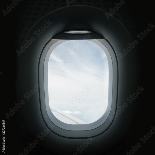 Looking Through An Airplane Window Porthole - 227266867