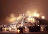 A model Christmas town with houses and a church on Christmas Eve. 3D Illustration.