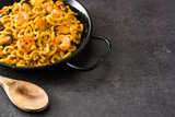 Traditional Spanish fideua. Noodle paella on black stone. Copyspace - 227271093