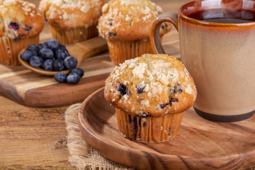 Blueberry Muffin and Cup of Coffee on a Wooden Plate