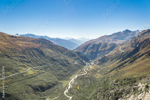 Foto Murales top view of a winding road in the swiss alps in autumn