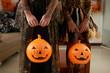 Quadro Crop shot of unrecognizable girls in beautiful Halloween dresses holding pumpkin lanterns