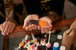 Quadro Close-up view of unrecognizable girls holding diy paper spiders over table with candies prepared for Halloween party