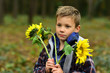 Small boy hold flowers for womans day. Small boy celebrate womans day. Celebrating international womans day. Equal rights for women every day