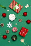 Gift boxes, Christmas balls, toys, fir cones, ribbon on green background. Festive, congratulation, New Year Christmas presents Xmas holiday 2019 greeting card. Flat lay, top view, copy space.
