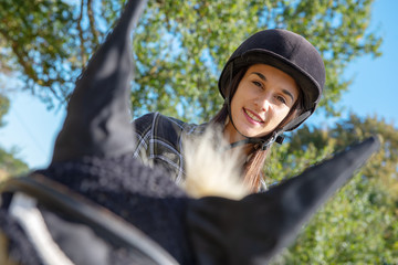 portrait of beautiful girl on horseback