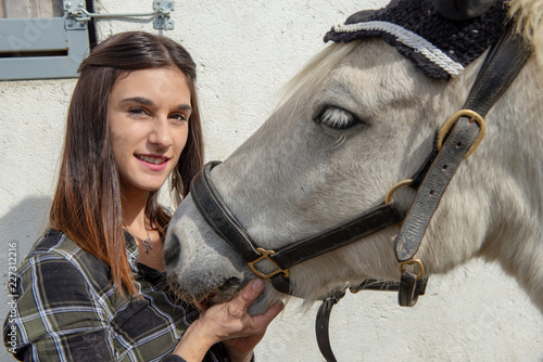 portrait of beautiful young woman rider with the white horse