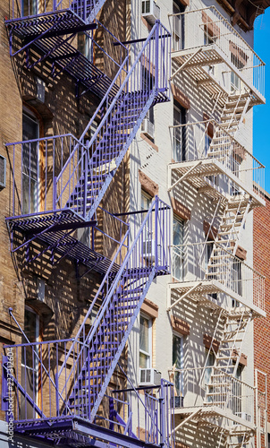 Fire escapes in New York, one of the city symbols, USA. - 227312604