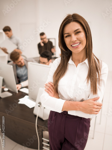 smiling businesswoman standing in a modern office