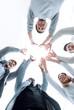 Leinwanddruck Bild - smiling business team standing in a circle