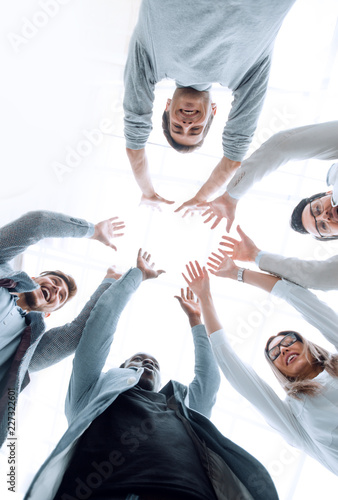 Leinwanddruck Bild smiling business team standing in a circle