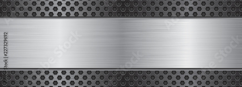Brushed metal texture. Steel plate on perforated background