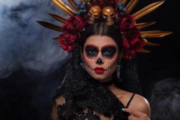 Creative image of Sugar Skull. Neon makeup for Halloween or Dia De Mertos holiday.