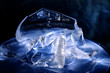 Colorful pieces of ice, painted with light. Still life, abstraction, background, texture
