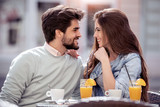 Happy couple spending time at coffee shop - 227336419