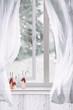 Wooden Reindeers Sitting In Window