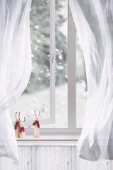 Wooden Reindeers Sitting In Window