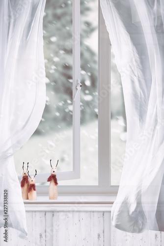 Foto Murales Wooden Reindeers Sitting In Window