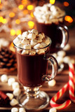 Cappuccino with marshmallow in glasses and candy cane on wooden table - 227340448