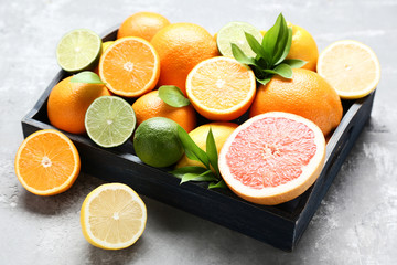 Citrus fruits in tray on wooden table