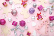 Christmas decorations on pink background