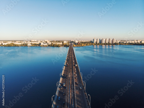 Aerial view of North Bridge with car traffic over Voronezh river and Left bank panorama