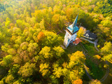 Aerial view to The Bolfanek viewtower with the St. Wolfgang´s cemetery chapel. Near a  marvelous village Chudenice from 12th century. Czech landmarks from above. Autumn in Central Europe. - 227361641
