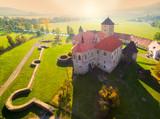 Aerial view to Svihov castle. Gothic architecture on river island. Beautiful landmark in national park Sumava, Czech Republic, Europe.- 227361678