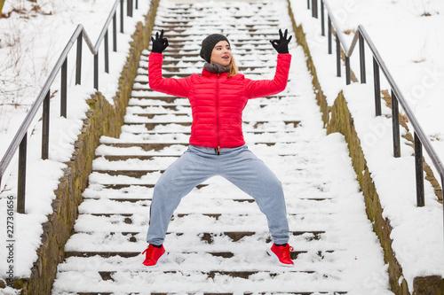 Foto Murales Woman wearing sportswear exercising outside during winter