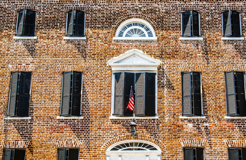 American Flag on Old Brick Building - 227361662