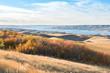 Sunset over autumn leaves on a hillside overlooking Lake Diefenbaker in the Saskatchewan Landing Provincial Park