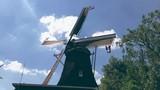 Dutch windmill turning around - 227392497