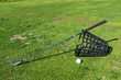Golf Club Leaning Next to Basket