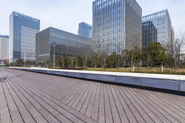 Panoramic skyline and modern business office buildings with empty road,empty concrete square floor © MyCreative