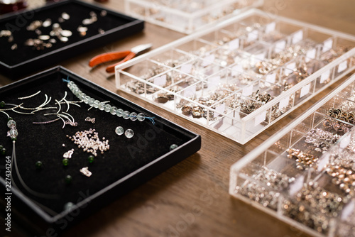 Tools for jewelry making, colorful stone beads. Jewellry workplace. © makistock
