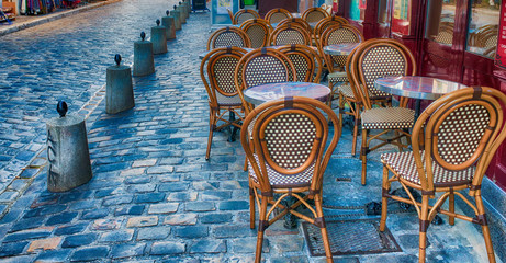 PARIS, FRANCE - DECEMBER 2012: Tourists visit Montmartre art district. The city attracts 40 million people every year